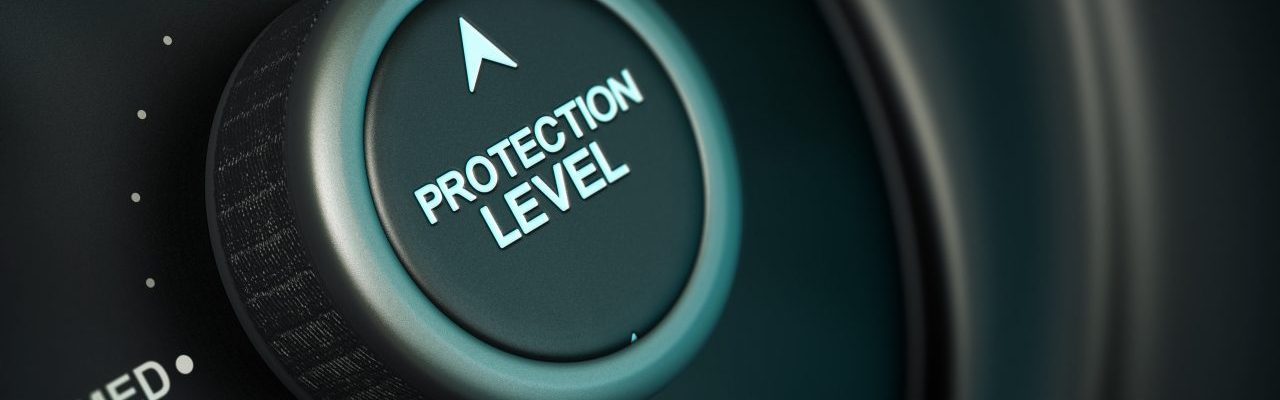 protection level button with low, medium and high positions, button is positioned in the highest position, black and blue background, blur effect